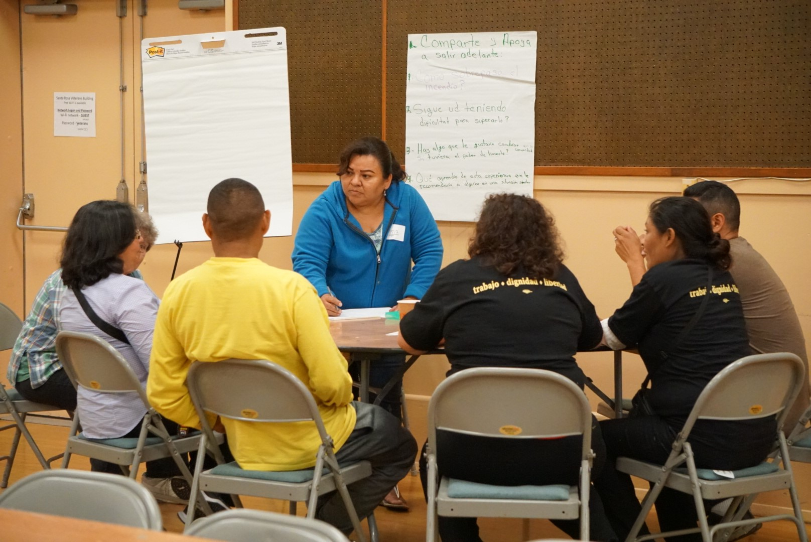 UndocuFund recipients share their experiences with a moderator during a dinner.